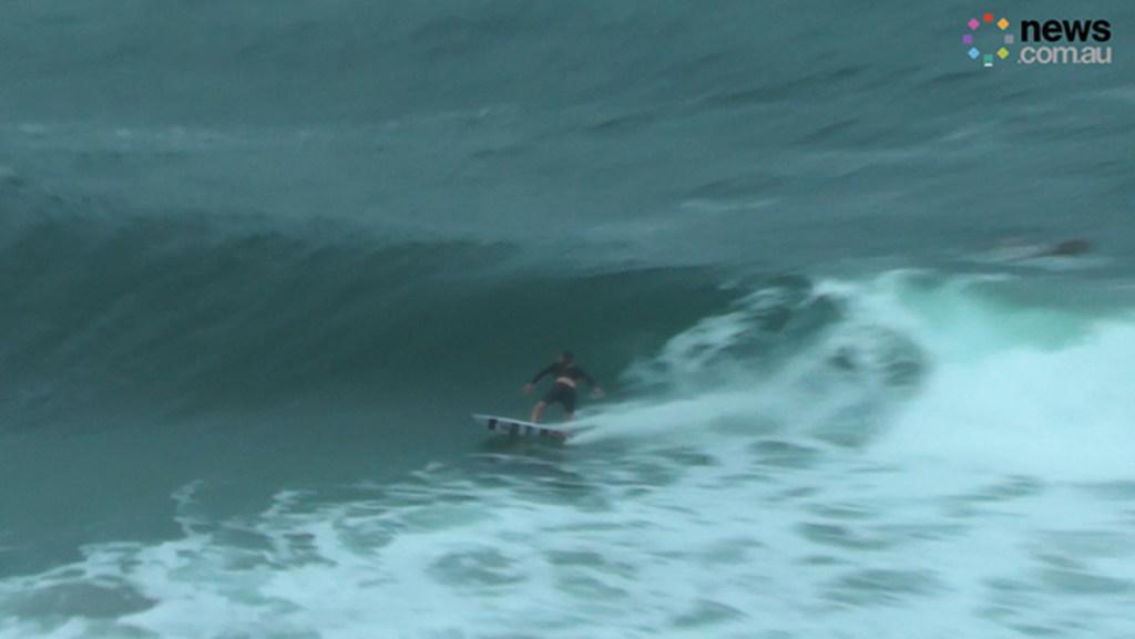 Chris Hemsworth surfs with Kelly Slater